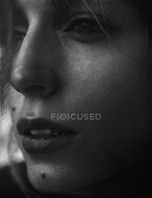 Woman face under veil — Stock Photo