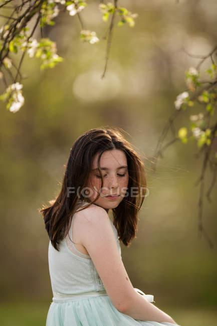Adorable brunette girl in white dress — Stock Photo