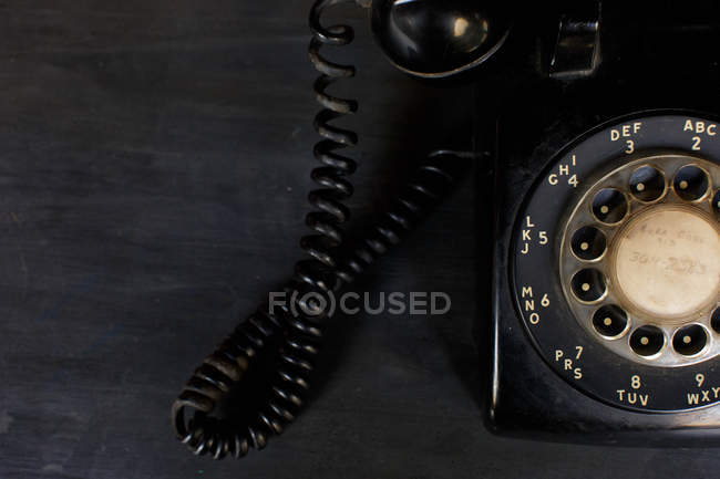 Black retro phone on table — Stock Photo