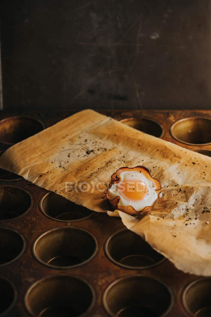 Delicious egg basket on baking paper over baking tray — Stock Photo