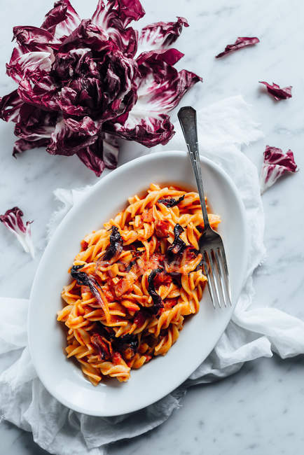 Red leaved chicory and fusilli pasta — Stock Photo