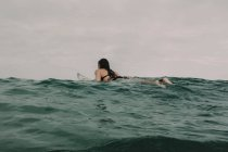 Surfer with surfboard in the ocean — Stock Photo