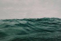 Ocean waves on overcast day — Stock Photo