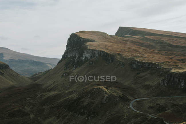 A road winding through the mountains — Stock Photo