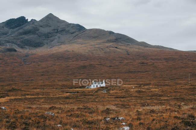 Lonely house at mountain hill — Stock Photo