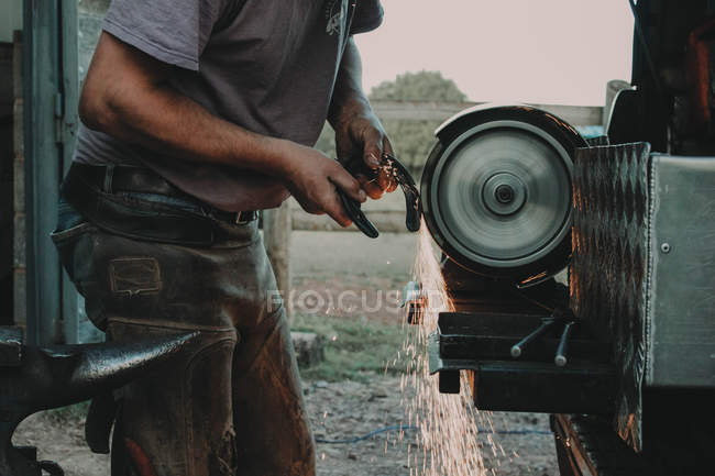 Blacksmith at hard work — Stock Photo