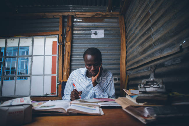 African young adult man studying — Stock Photo
