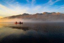 Canoe pass through fog — Stock Photo