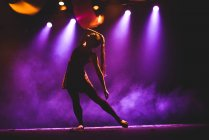 Young girl dancing on stage — Stock Photo