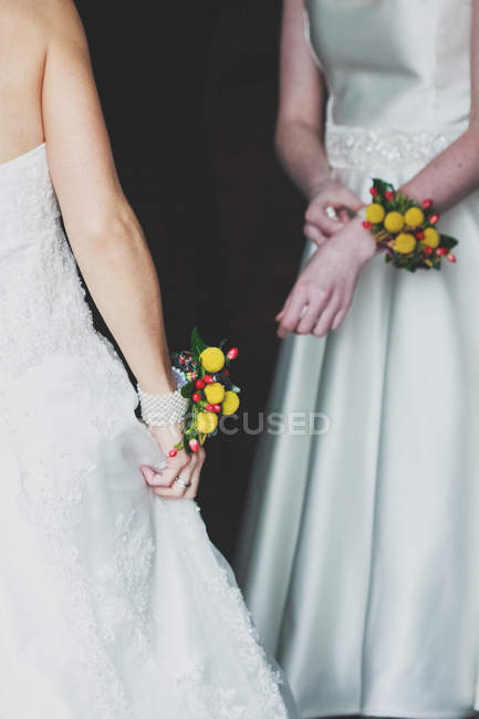 Couple with bouquets on hands — Stock Photo