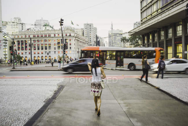 Woman walking on street — Stock Photo