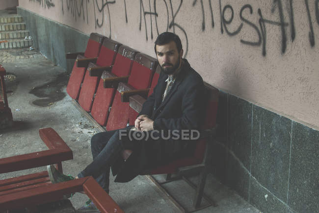 Hipster man sitting on chair — Stock Photo