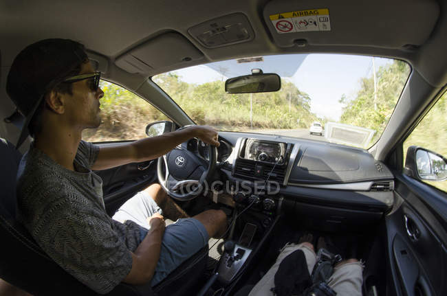Young man traveling around central america while driving car,  central america — Stock Photo