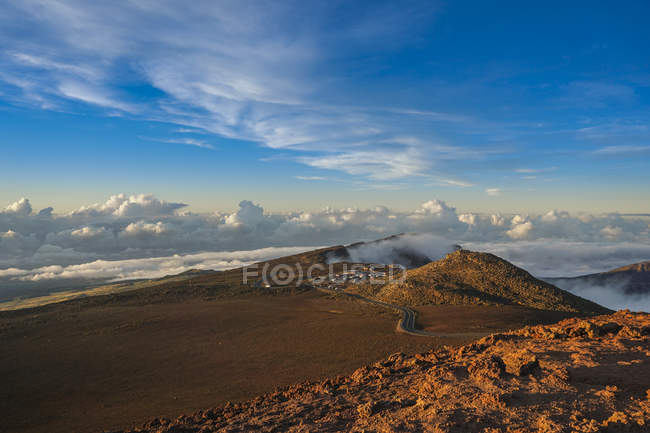 View of mountain plain with stones and sand over clouds ,Haleakal National Park, East Maui Volcano, Hawaii, Usa — Stock Photo