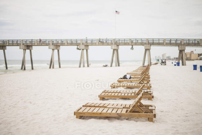 Panama city beach with wavy water benches in a row and