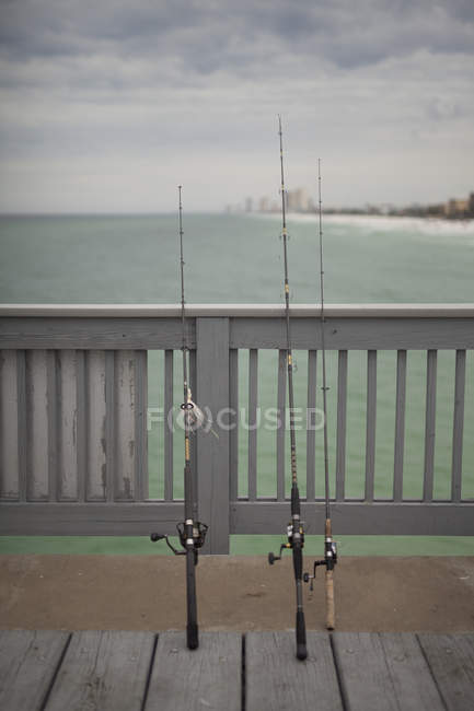 Panama city beach with wavy water and wooden pier and