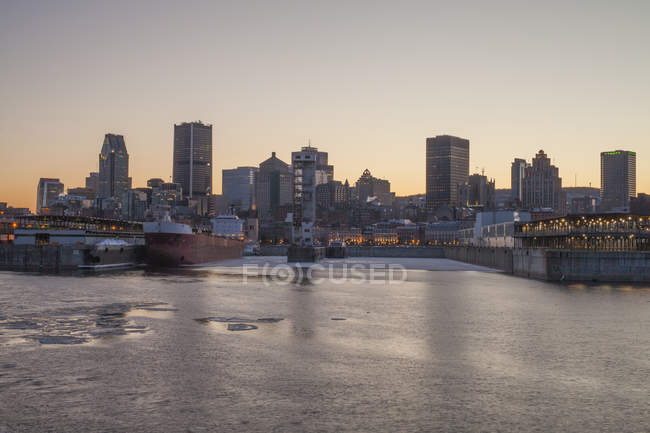 Montreal cityscape at night with water on foreground — Stock Photo