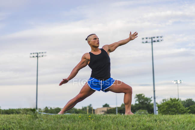 Athletic man performing yoga asana while working out — Stock Photo