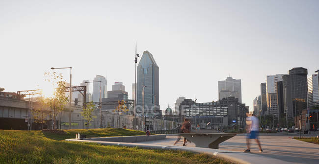 Panoramic shot of public park in downtown urban area — Stock Photo