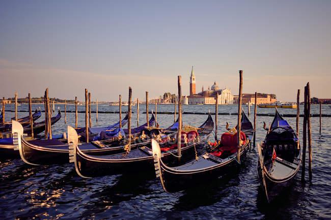 Venetian gondolas in the adriatic sea on the edge of San Marco, Venice, Italy — Stock Photo