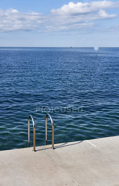 Close-up of Pool ladder on shore of sea — Stock Photo