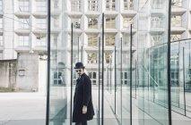 Man standing near building — Stock Photo