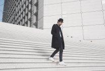 Man walking down stairs — Stock Photo