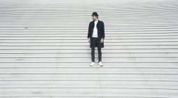 Man standing on stairs — Stock Photo