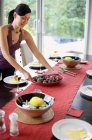 Woman setting the dining table — Stock Photo