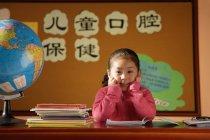 Girl sitting in class — Stock Photo