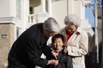 Elderly couple with grandson — Stock Photo