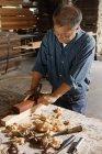 Craftsman working with block plane — Stock Photo