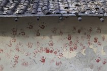 Red hand prints on wall — Stock Photo