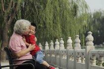 Grandmother hugging and kissing grandson — Stock Photo