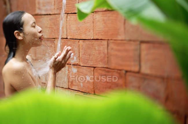 Woman taking shower — Stock Photo