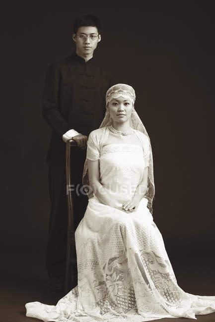 Couple, studio portrait — Stock Photo