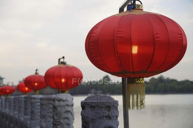 Chinese lanterns on fence — Stock Photo