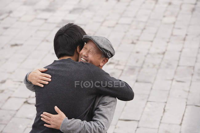 Grandfather and grandson hugging — Stock Photo