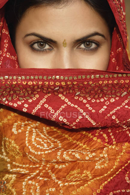 Woman in sari, covering face — Stock Photo