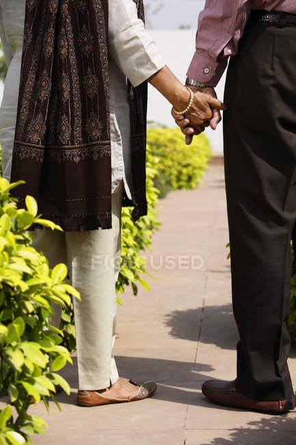 Senior couple with clasped hands — Stock Photo