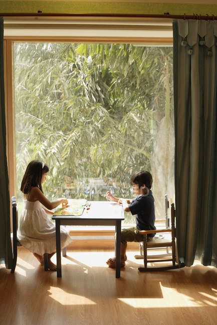 Children playing at table — Stock Photo