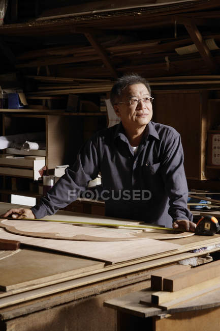 Carpenter working with wood on table — Stock Photo