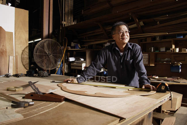 Craftsman working in wood shop — Stock Photo