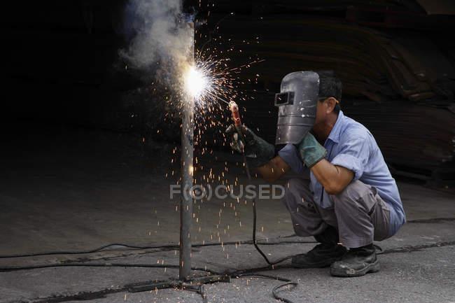 Mature man welding — Stock Photo