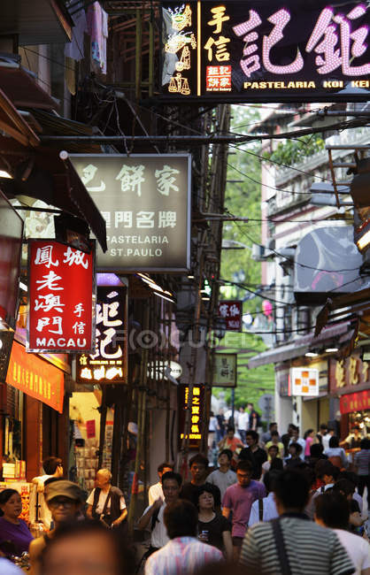 Crowded street with banners and signs — Stock Photo