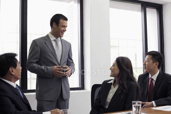 Man standing and talking in office — Stock Photo