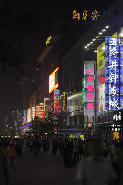 Neon signs with Chinese characters at night — Stock Photo