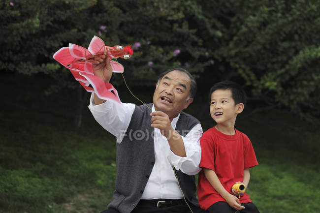 Grandfather and grandson playing — Stock Photo
