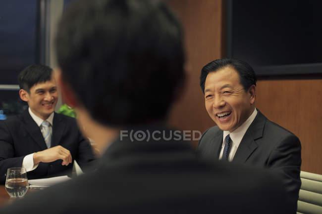 Three businessmen laughing — Stock Photo
