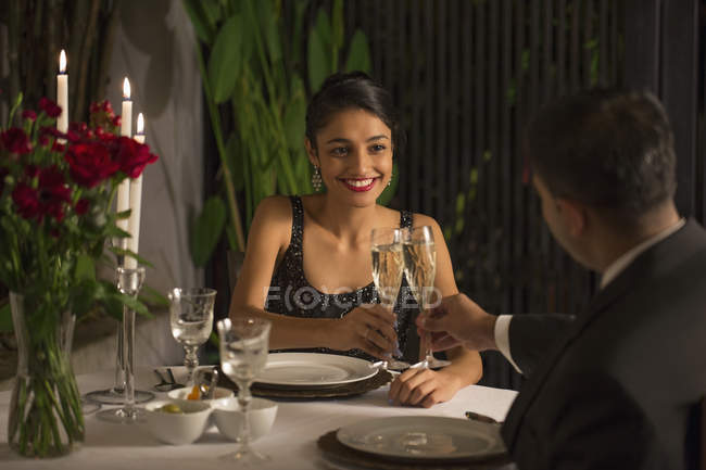 Man and woman at romantic dinner — Stock Photo